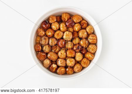 Process Of Soaking Various Nuts: Hazelnuts In Water To Activate. Home Cooking: Making Plant Based Or