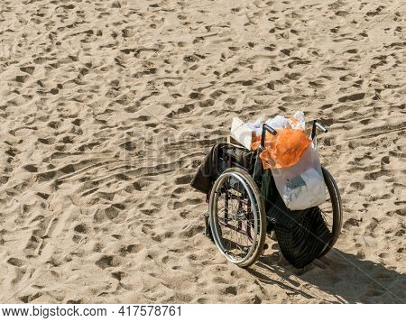 wheelchair on the beach in the sand