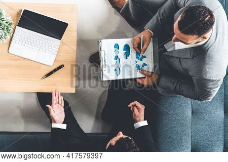 Businessman Is In Meeting Discussion With Another Businessman Partner In Modern Workplace Office. Pe