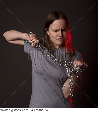 Young Woman Ties With Chain, Suffer From Despair, Psychological Problems. Unhappy Person With Heavy