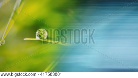 Composition of drop of water on grass with screen of smoke. global environment, sustainability, global warming and climate change concept digitally generated image.