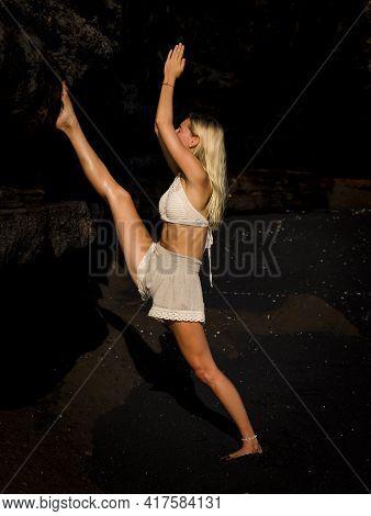 Yoga Practice. Slim Caucasian Woman Practicing Samsahate Hanumanasana, Standing Split Pose. Hands Ra