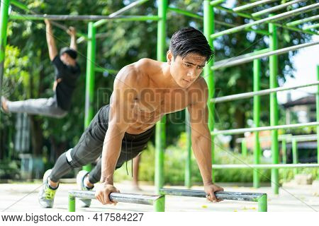 Sexy Muscular Man Doing Push Up Movement Shows His Muscular Arms When Exercising Outdoors