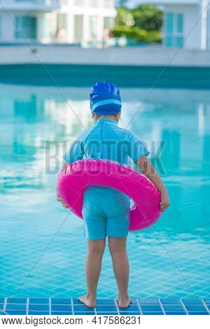 Cute Girl With Goggles Having Fun In Summer In The Pool Summer Vacation Concept