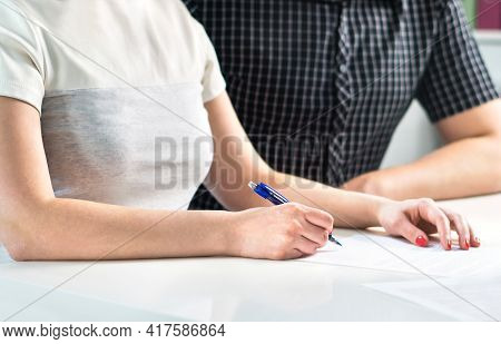 Couple Writing A Plan, Counting Family Budget Or Signing Contract Settlement. Wife And Husband Makin