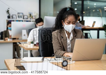 Group Of Asian Team Business People Working In Office With New Normal Social Distancing Lifestyle Co