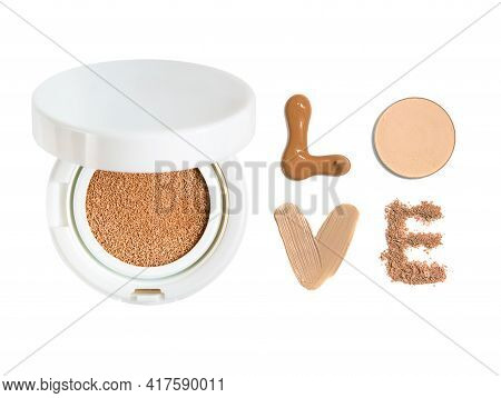 Powder Cushion With The Inscription Love From Samples Of Powder And Foundation Cream. Cosmetic Face