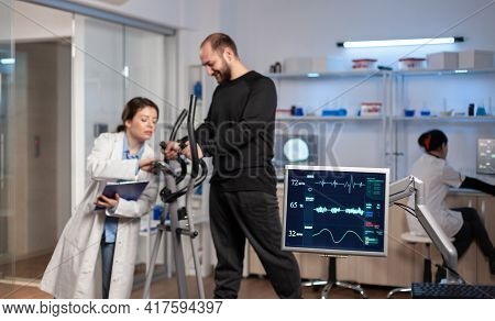 Team Of Medial Researchers Monitoring Vo2 Of Man Sport Performance
