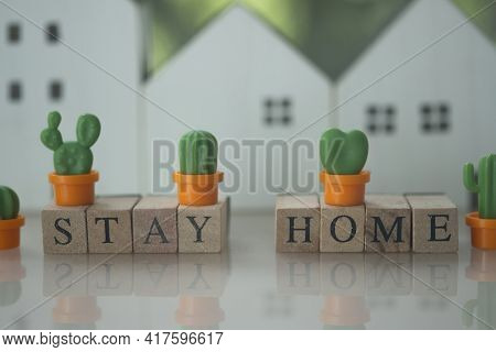 Wooden Cube Block With Stay Home With Miniature Cactus White Wood Home Blur Background. The Concept