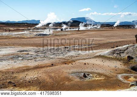 Hverir, Iceland - July 24, 2017: Visitors Admiring The Steaming Volcanic Pools At Hverir, Myvatn, No