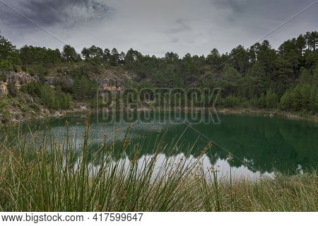 Views Of The Gypsy Lagoon, A Karstic Lake Located In The Natural Monument Of Cañada Del Hoyo Lagoons