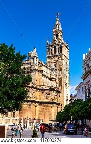 Seville, Andalusia, Spain - May 12, 2013: The Giralda Is The Bell Tower Of The Seville Cathedral.
