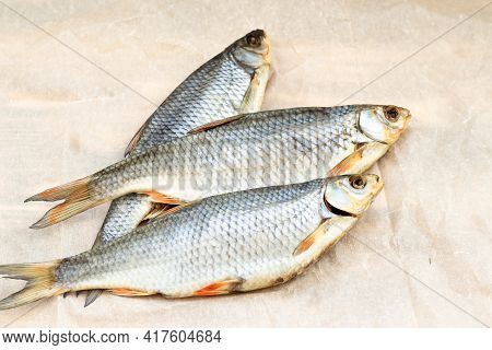 Fish Dry Roach 3 Pieces On Food Paper.