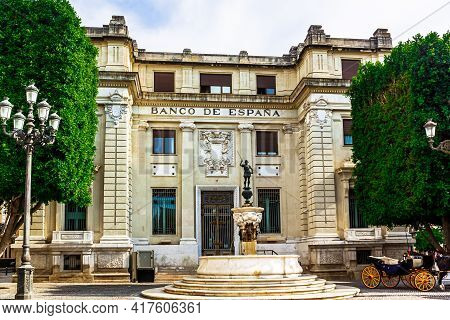 Seville, Andalusia, Spain - May 12, 2013: The Building Of The Bank Of Spain With The Mercury Fountai