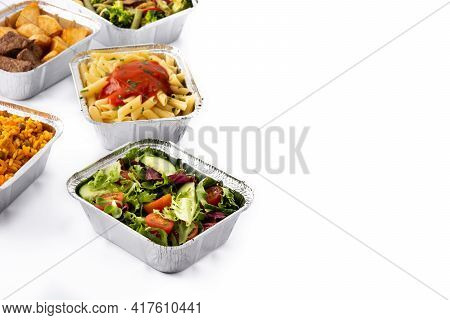 Take Away Healthy Food In Foil Boxes Isolated On White Background. Copy Space