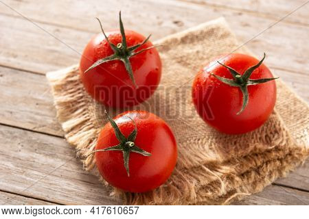 Organic Fresh Tomatoes On Rustic Wooden Table
