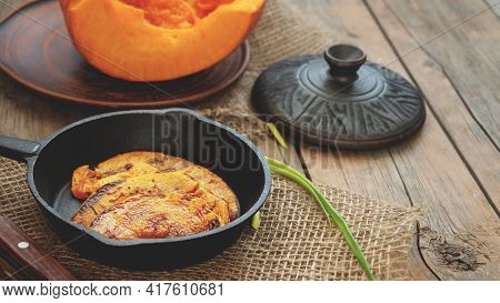 Grilled Pumpkin Slices. Pumpkin Slices Served In A Frying Pan, Close-up.