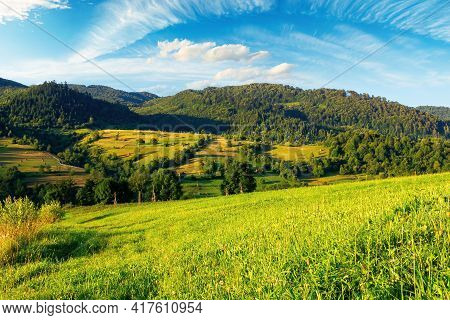Rural Fields In The Morning Light. Wonderful Mountainous Countryside Scenery With Grassy Hills In Su