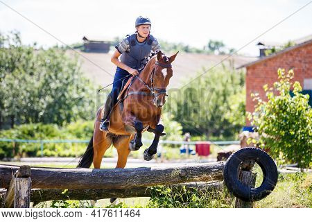 Rider Jumps Horse Over Log On Cross-country Course