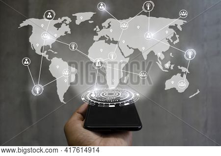 5g. Smartphone On Hand With Global Media Link Connecting On International World Map Background, Digi