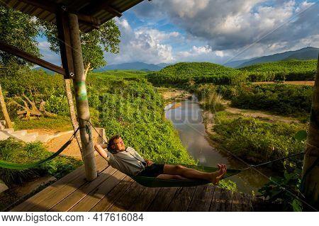 Man On Hammock Phong Nha Vietnam