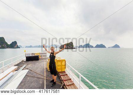 Beautiful Landscape With Young Smiling Woman Of Bai Tu Long Bay, Taken During Cruise To Quan Lan Isl