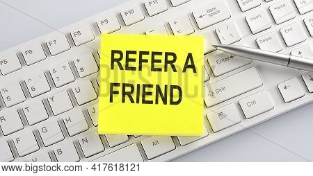 Text Refer A Friend On Keyboard On The White Background
