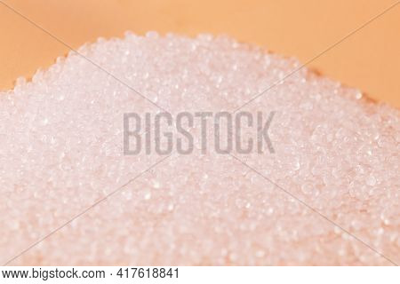 Transparent Polypropylene Balls On A Coral Colored Background.