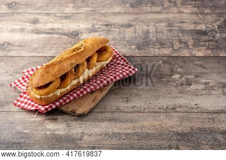 Calamari Rings Sandwich On Wooden Table, Typical Food From Madrid