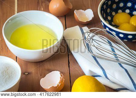 Egg Yolk And Egg White And Whisk Before Beating