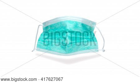 Medical Disposable Mask, White Background. Green Surgical Mask, Cover The Mouth And Nose. Respirator