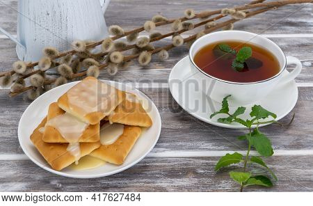 Delicious Cookies With Condensed Milk And Black Tea With Mint. Selective Focus. Light Breakfast Is S