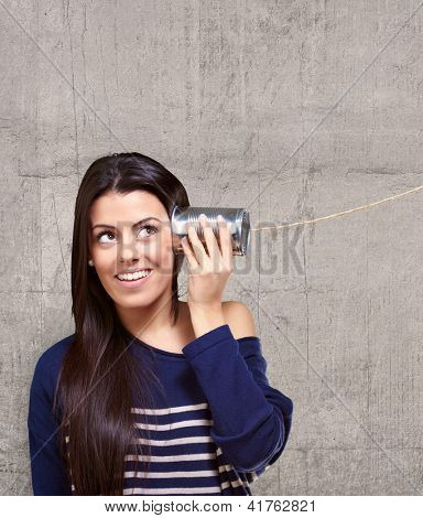 Female Holding A Metal Tin As A Telephone, Background