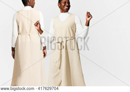 African American woman wearing beige dress  for apparel ad