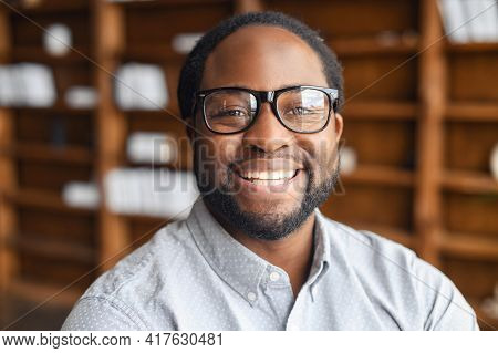 Close-up Portrait Of A Happy African-american Young Man With Friendly Wide Toothy Smile, A Mixed-rac