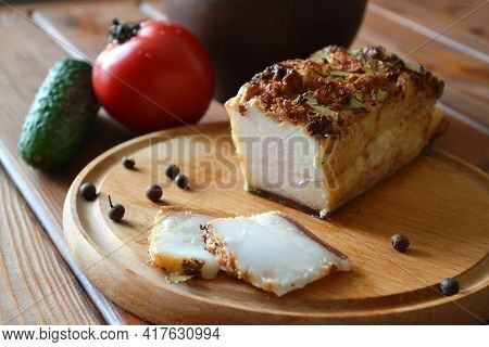 Salo - Traditional Ukrainian Snack, Sliced Pork Lard Baked With Spices On The Round Wooden Plate