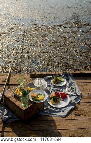 Fish Patties Fishing Near The River. Daylight .selective Focus