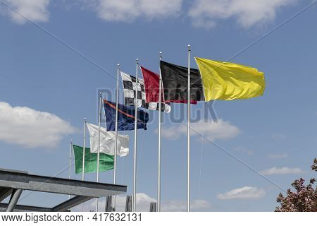 Indianapolis - Circa April 2021: The Seven Racing Flags At Indianapolis Motor Speedway. Ims Is Prepa