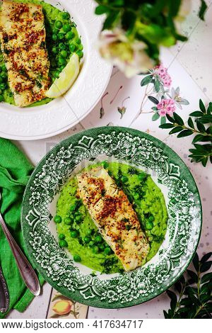 Sauteed Cod With Pea Cream...style Rustic.selective Focus