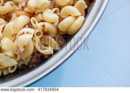 Navy Pasta With Meat. Blurred Image For Background. Navy Pasta With Beef Stew In A Frying Pan Tradit