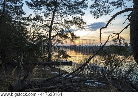 River Sunset Quiet Landscape View. Evening By The River. Pine Trees Against The Background Of The Ev
