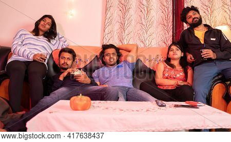 Concept Of Lazy Weekend Or Boring Movie - Group Of Young Friends Watching Uninteresting Web Series W