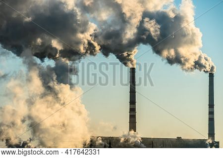 Smoking Factory Chimneys With Co2 Emissions.environmental Problem Of Environmental And Air Pollution