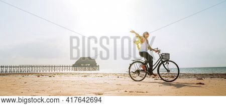 Young Female Dressed Light Summer Clothes Joyfully Threw Up Her Hand Riding Old Vintage Bicycle With