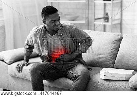 African Man Touching Aching Abdomen Having Stomach Pain At Home