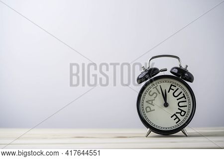 Alarm Clock Running For Change From Past To Future On Wooden Table With Copy Space.