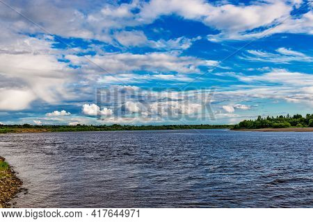 Summer Landscape With River And Blue Sky With Clouds