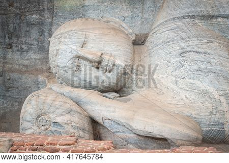 Beautiful Face Of Reclining Buddha Is 14 M Long, Picturing Buddha Entering Nirvana At Gal Vihara In