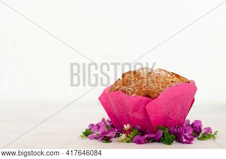 Homemade Easter Cupcake On A White Background. Festive Pastries, Spring Flowers In The Decor Of The