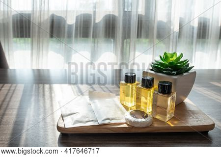 Set Of Hotel Amenities (such As Shampoo, Soap Etc) On The Table In Hotel Bedroom. Hotel Amenities Is